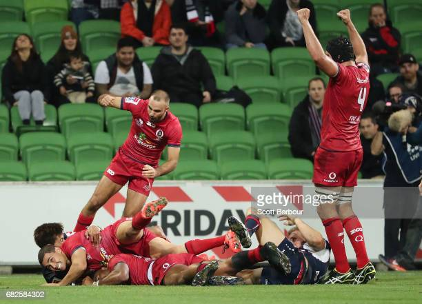The Reds celebrate as Samu Kerevi of the Reds scores the matchwinning try during the round 12 Super Rugby match between the Melbourne Rebels and the...