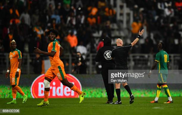 The referee abandons the match after repeated pitch invasions during the International Friendly match between the Ivory Coast and Senegal at the...