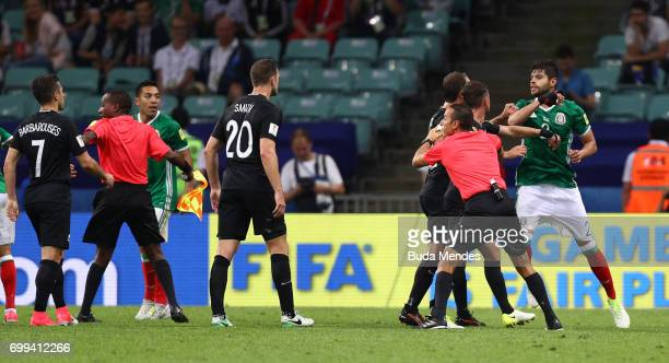 The referee and assistnat referee attempt to calm both sets of players down after clashing during the FIFA Confederations Cup Russia 2017 Group A...