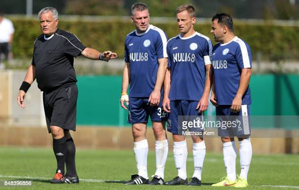 The referee and players of SpVg Blau Weiss 1890 are pictured during the DFB over 40 and 50 cup at Amateurstadion on September 17 2017 in Berlin...