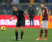 The referee Andrea De Marco checks the field condition as Kevin Strootman watches during the Serie A match between AS Roma and Parma FC at Stadio...