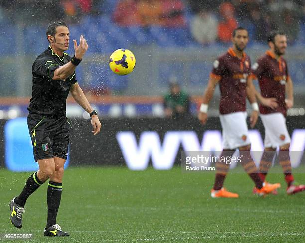 The referee Andrea De Marco checks the field condition during the Serie A match between AS Roma and Parma FC at Stadio Olimpico on February 2 2014 in...