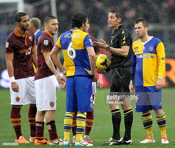 The referee Andrea De Marco speaks with the players to check the field condition during the Serie A match between AS Roma and Parma FC at Stadio...
