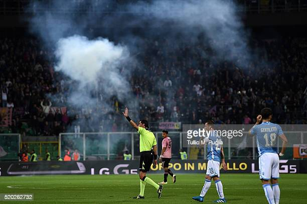 The referee Andrea Gervasoni stops the match after firecrackers are thrown during the Serie A match between US Citta di Palermo and SS Lazio at...