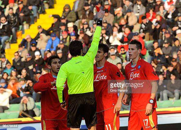 The referee Antonio Damato a red card to Christian Maggio of Napoli during the Serie A match between Udinese and Napoli at Stadio Friuli on February...