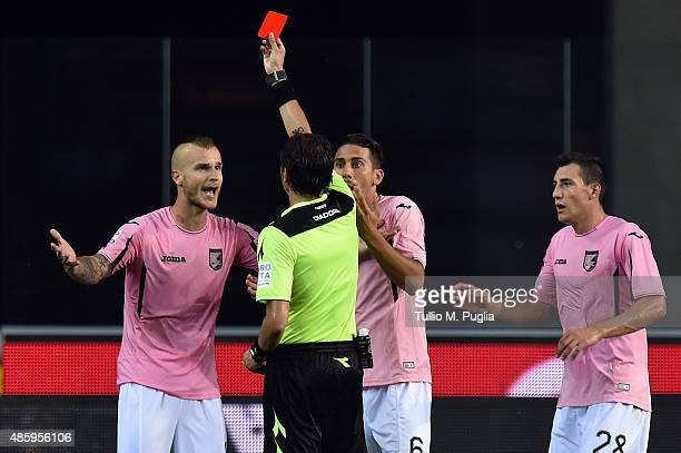 The referee Antonio Damato gets a red card to Aljaz Struna of Palermo during the Serie A match between Udinese Calcio and US Citta di Palermo at...