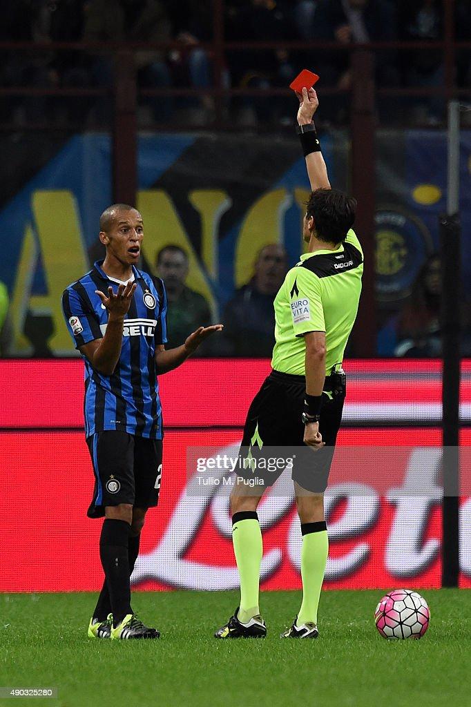 The referee Antonio Damato shows the red card to Joao Miranda of Internazionale Milano during the Serie A match between FC Internazionale Milano and...
