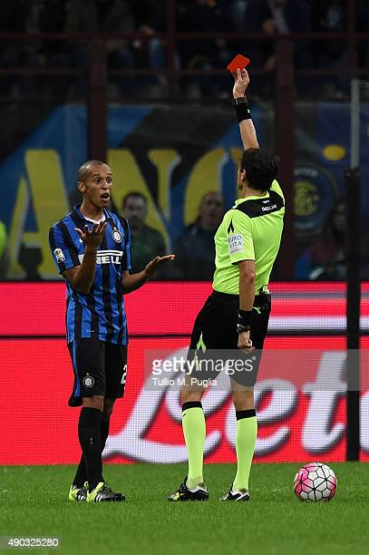 The referee Antonio Damato shows the red card to Joao Miranda of Internazionale Milano during the Serie A match between FC Internazionale Milano and...