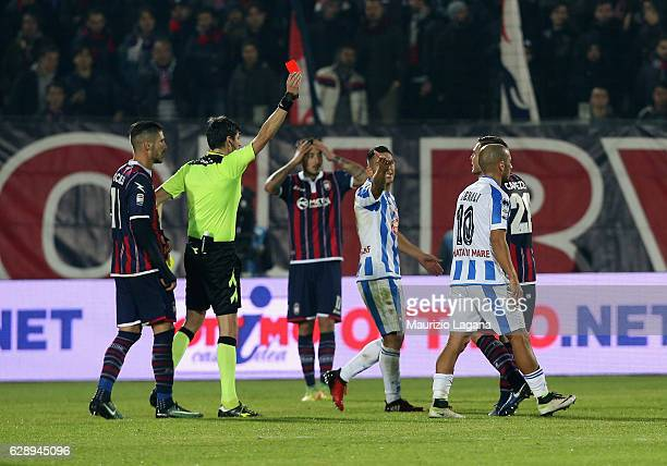 The referee Antonio Damato shows the red card to Leonardo Capezzi of Crotone during the Serie A match between FC Crotone and Pescara Calcio at Stadio...