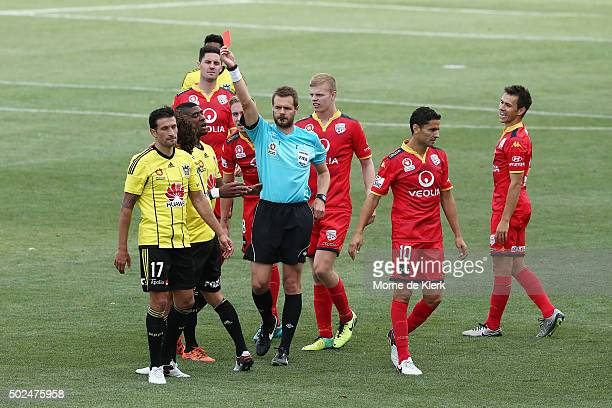 The referee awards a second yellow card to Albert Riera of Wellington Phoenix to send him off the field during the round 12 ALeague match between...