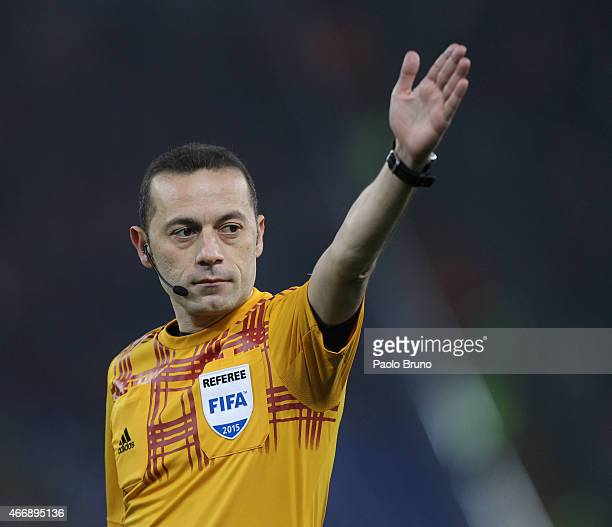 The referee Cakir Cuneyt gestures during the UEFA Europa League Round of 16 match between AS Roma and ACF Fiorentina at Olimpico Stadium on March 19...