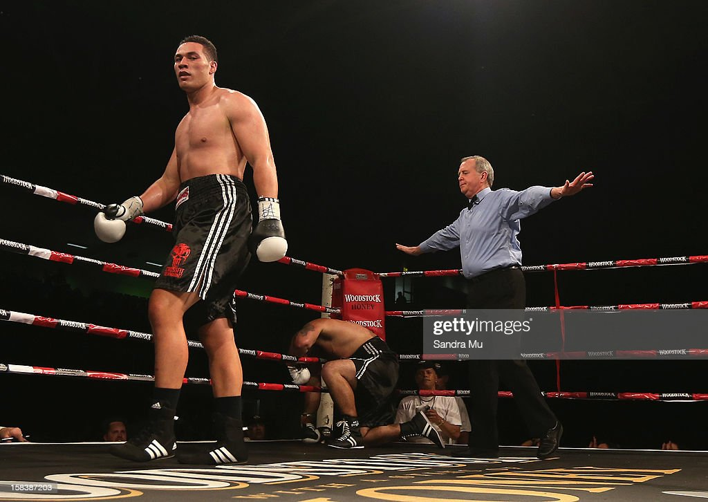 The referee calls off the fight after Joseph Parker (L) knocked down Richard Tutaki during the professional bout between Joseph Parker and Richard Tutaki during the 2012 Fight for Life at Trusts Stadium on December 15, 2012 in Auckland, New Zealand.