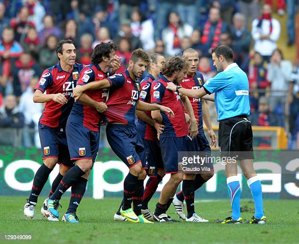 The referee calms the players after Kakha Kaladze of Genoa CFC is given a red card during the Serie A match between Genoa CFC and US Lecce at Stadio...
