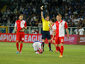 The referee cautions a player of Vojvodina during the preliminary of Europa League match between UC Sampdoria and FK Vojvodina at the Olympic Stafium...