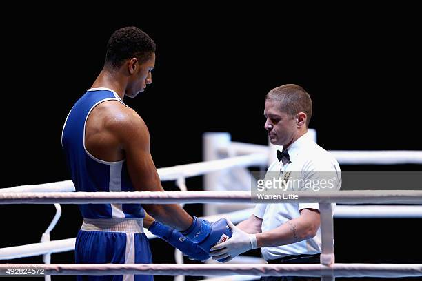 The referee check the gloves of Tony Yoka of France as he prepares to fight Ivan Dychko of Kazakhstan in the final of the Men's Super Heavy Weight...