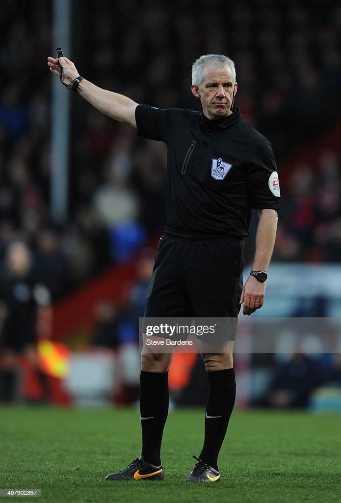 The Referee <a gi-track='captionPersonalityLinkClicked' href=/galleries/search?phrase=Chris+Foy+-+Referee&family=editorial&specificpeople=696483 ng-click='$event.stopPropagation()'>Chris Foy</a> during the Barclays Premier League match between Crystal Palace and West Bromwich Albion at Selhurst Park on February 8, 2014 in London, England.