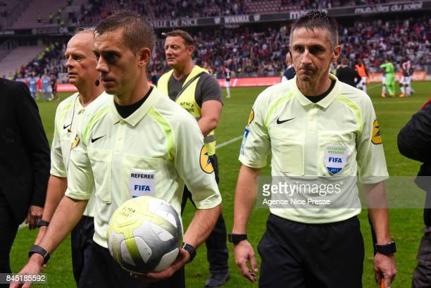 The referee Clement Turpin and his assistants Cyril Gringore and Nicolas Danos during the Ligue 1 match between OGC Nice and AS Monaco at Allianz...