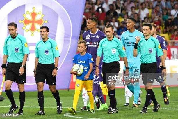 The referee Clement Turpin and his assistants Husseyn Ocak Gilles Lang and Alexandre Perreau Niel during the Ligue 1 match between AS Monaco and...