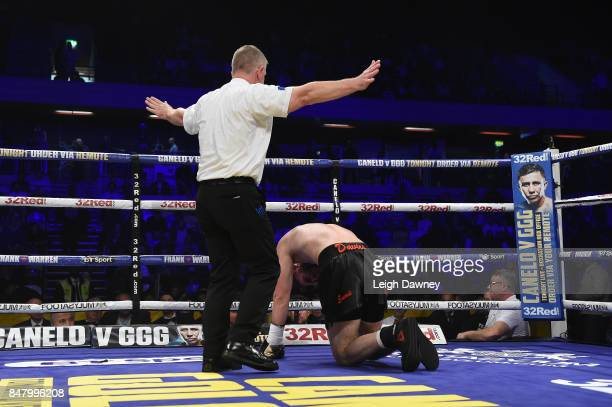 The referee counts Jack Davies out after Ryan Hatton knocks him down in Hatton's professional debut fight at Copper Box Arena on September 16 2017 in...