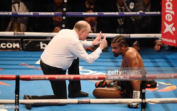 The referee counts over British boxer David Haye after he was knocked to the canvas by compatriot Tony Bellew during their heavyweight boxing match...