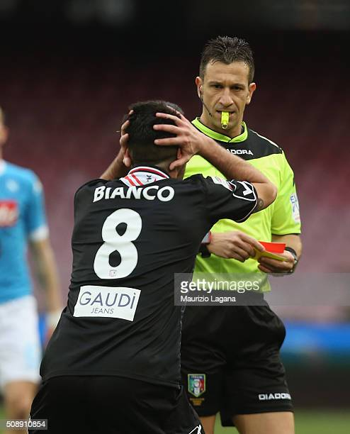 The referee Daniele Doveri shows the red card to Raffaele Bianco of Carpi during the Serie A match between SSC Napoli and Carpi FC at Stadio San...