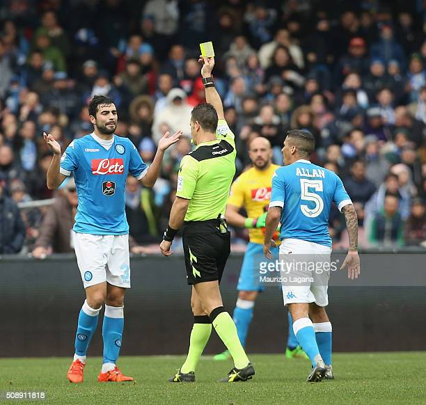 The referee Daniele Doveri shows the yellow card to Raul Albiol of Napoli during the Serie A match between SSC Napoli and Carpi FC at Stadio San...