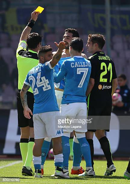 The referee Domenico Celi shows the yellow card to Raul Albiol of Napoli during the Serie A match between SSC Napoli and Hellas Verona FC at Stadio...