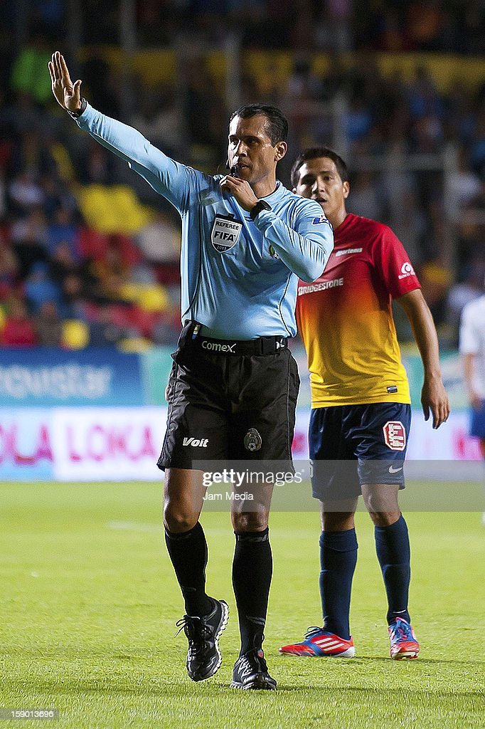 The referee Emir Ramirez in action during a match between Morelia and Cruz Azul as part of the Clausura 2013 Liga MX at Morelos Stadium on january 04, 2013 in Morelia, Mexico.