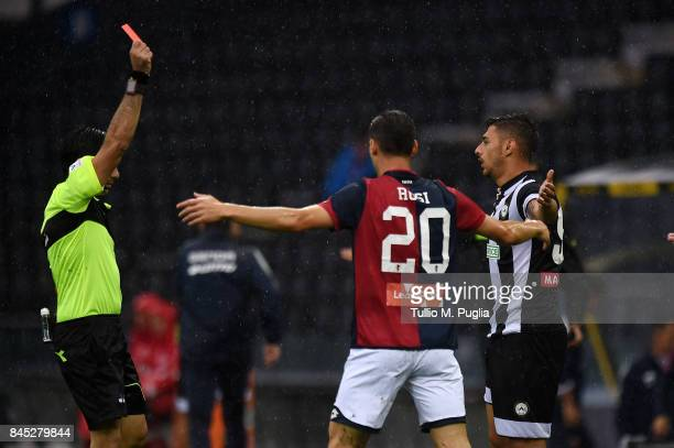 The referee Fabio Maresca gets a red card to Giuseppe Pezzella of Udinese during the Serie A match between Udinese Calcio and Genoa CFC at Stadio...