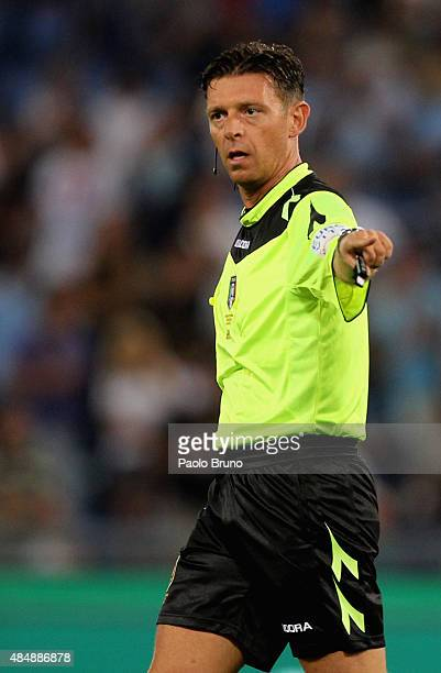 The referee Gianluca Rocchi gestures during the Serie A match between SS Lazio and Bologna FC at Stadio Olimpico on August 22 2015 in Rome Italy