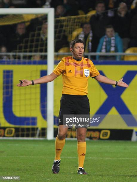 The referee Gianluca Rocchi reacts during the UEFA Europe League Group L football match between Lokeren and Trabzonspor at Daknam Stadium in Lokeren...