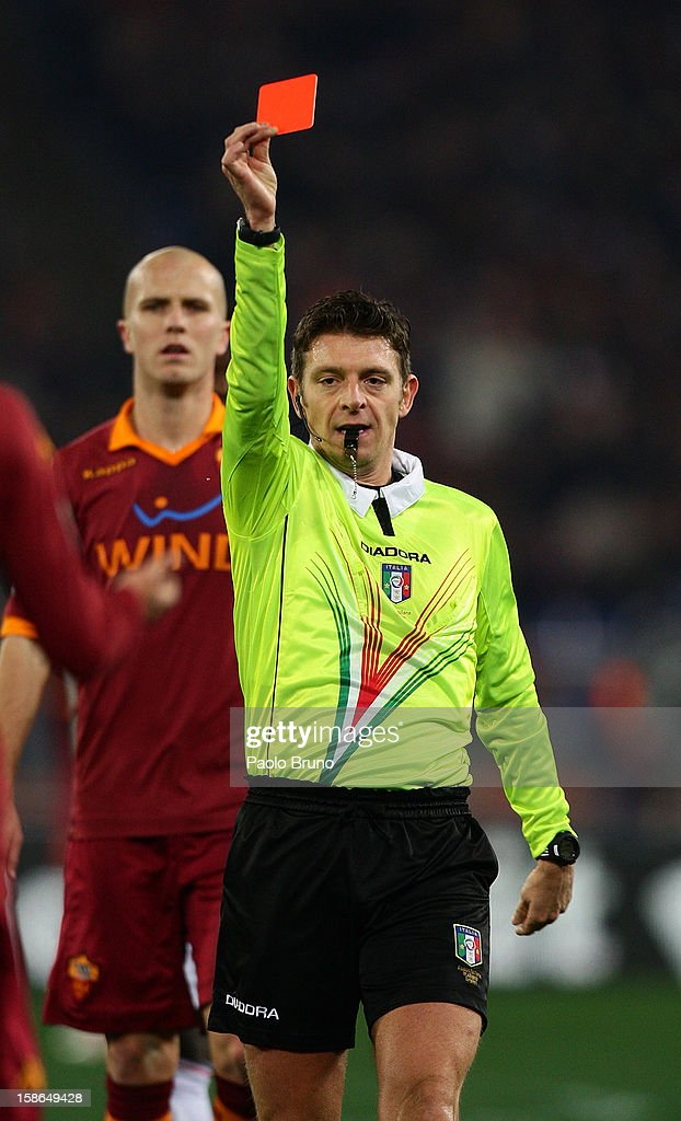 The referee Gianluca Rocchi shows the red card to Marquinhos of AS Roma during the Serie A match between AS Roma and AC Milan at Stadio Olimpico on December 22, 2012 in Rome, Italy.