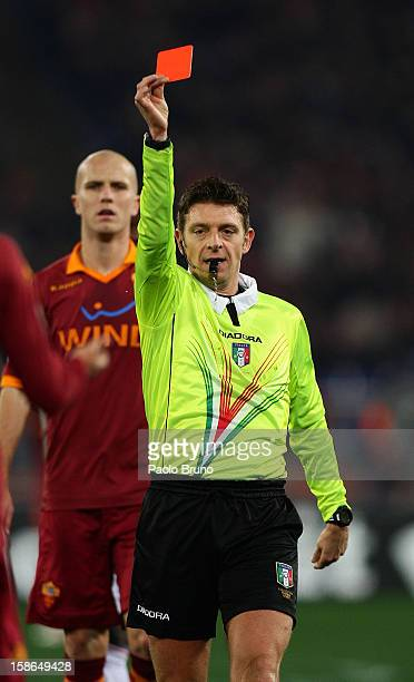 The referee Gianluca Rocchi shows the red card to Marquinhos of AS Roma during the Serie A match between AS Roma and AC Milan at Stadio Olimpico on...