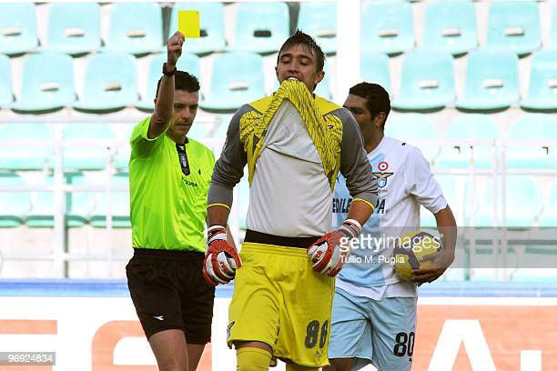 The referee Gianluca Rocchi shows the yellow card to Goalkeeper Fernando Muslera of Lazio during the Serie A match between US Citta di Palermo and SS...