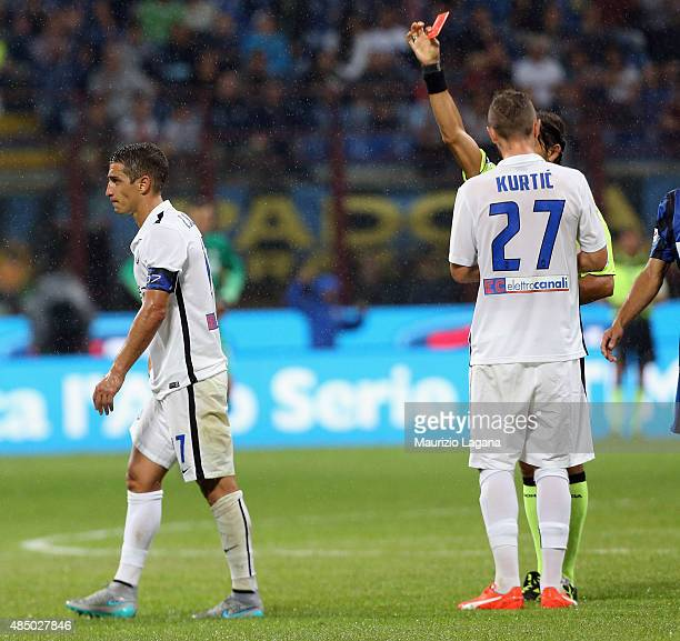 The referee Gianpaolo Calvarese shows the red card to Carlos Carmona of Atalanta during the Serie A match between FC Internazionale Milano and...