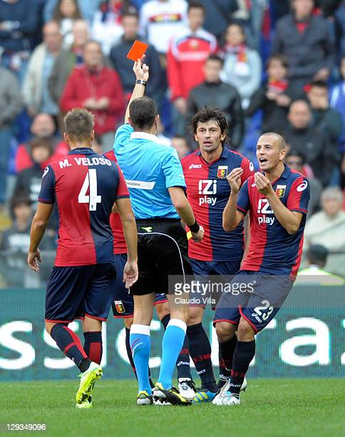 The referee gives a red card to Kakha Kaladze of Genoa CFC during the Serie A match between Genoa CFC and US Lecce at Stadio Luigi Ferraris on...