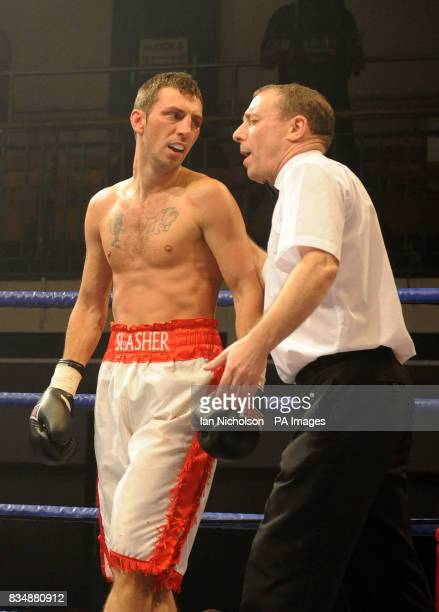 The referee holds Shaun Walton at the end of the LightWelterweight contest with High Wycombe's Gareth Couch at Bethnal Green's York Hall