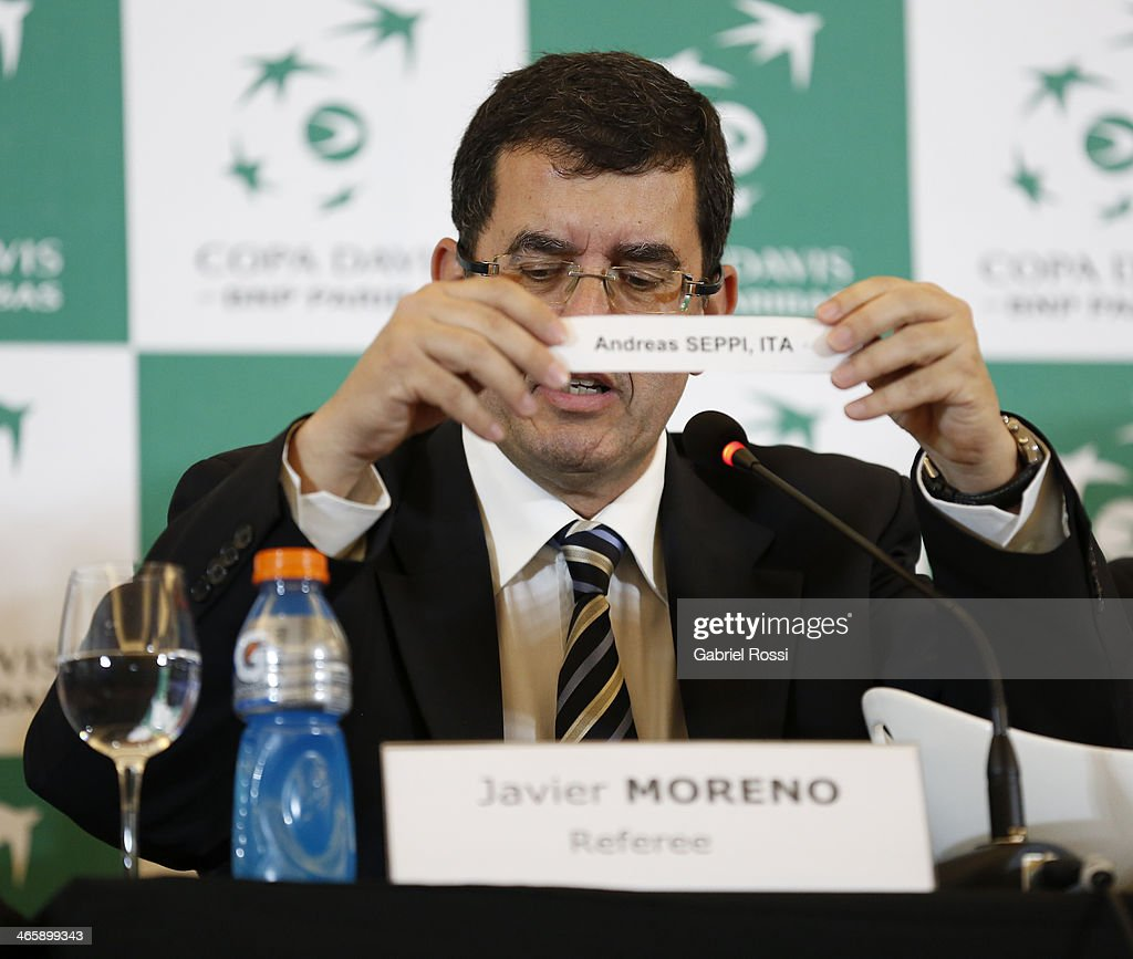 The Referee Javier Moreno shows the results during the Copa Davis Draw between Argentina and Italy as part of the Copa Davis at NH Hotel on January 30, 2014 in Buenos Aires, Argentina.
