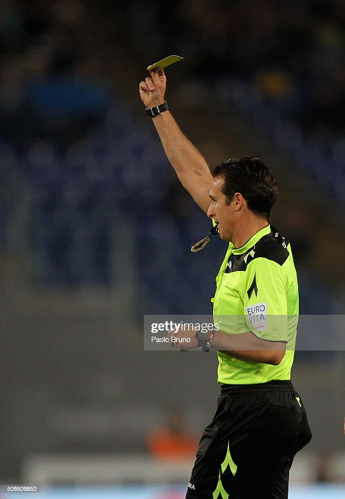 The referee Luca Banti gestures during the Serie A match between SS Lazio and FC Internazionale Milano at Stadio Olimpico on May 1, 2016 in Rome, Italy.