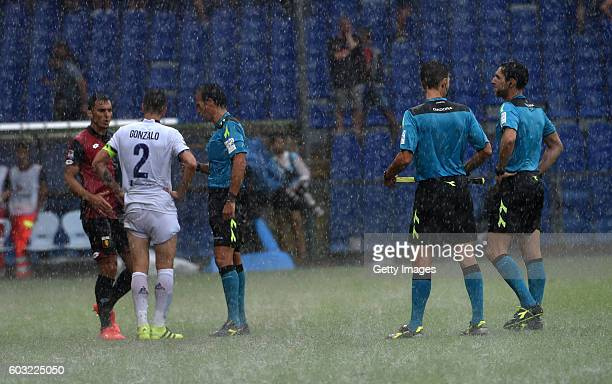 The referee Luca Banti talks to players before suspending the match due to waterlogged pitch during the Serie A match between Genoa CFC and ACF...