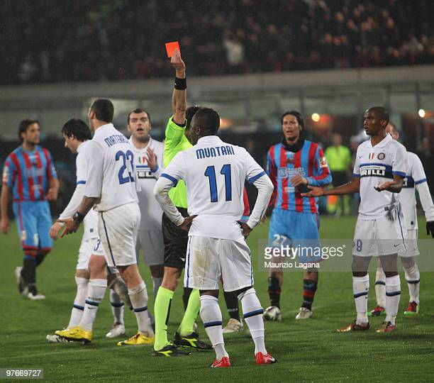 The referee Luca Valeri shows a red card to Sulley Muntari of FC Internazionale Milano during the Serie A match between Catania Calcio and FC...
