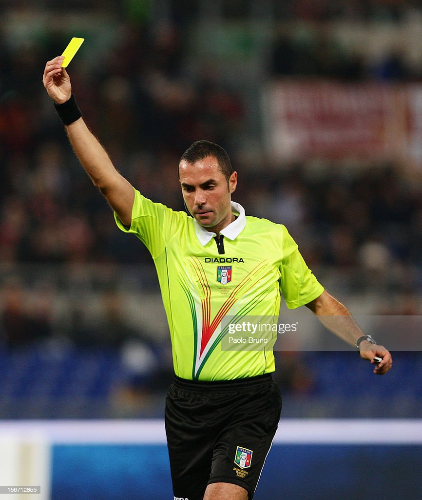 The referee Marco Guida shows the yellow card during the Serie A match between AS Roma and Torino FC at Stadio Olimpico on November 19, 2012 in Rome, Italy.