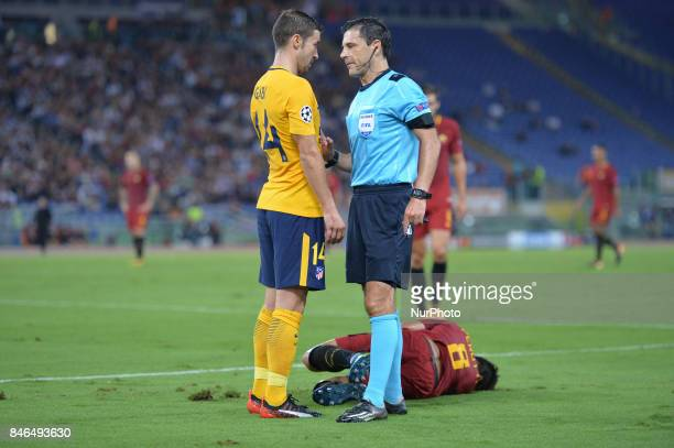 The referee Milorad Mazic and Gabi during the UEFA Champions League group C football match AS Roma vs Atletico Madrid FC at the Olympic Stadium in...