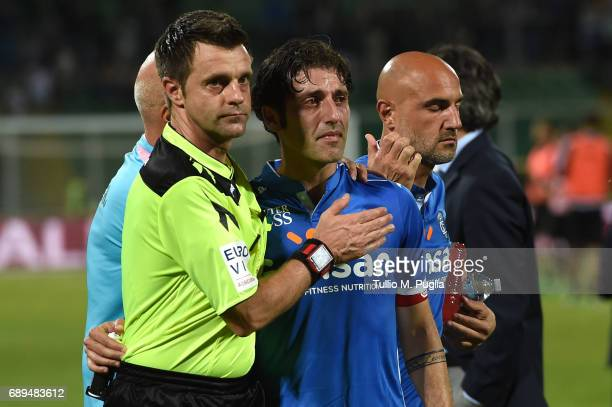 the referee Nicola Rizzoli consoles Daniele Croce after losing the Serie A match between US Citta di Palermo and Empoli FC at Stadio Renzo Barbera on...