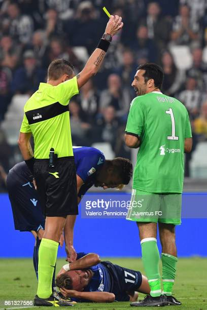 the referee Paolo Mazzoleni show the yellow card to Gianluigi Buffon of Juventus during the Serie A match between Juventus and SS Lazio on October 14...