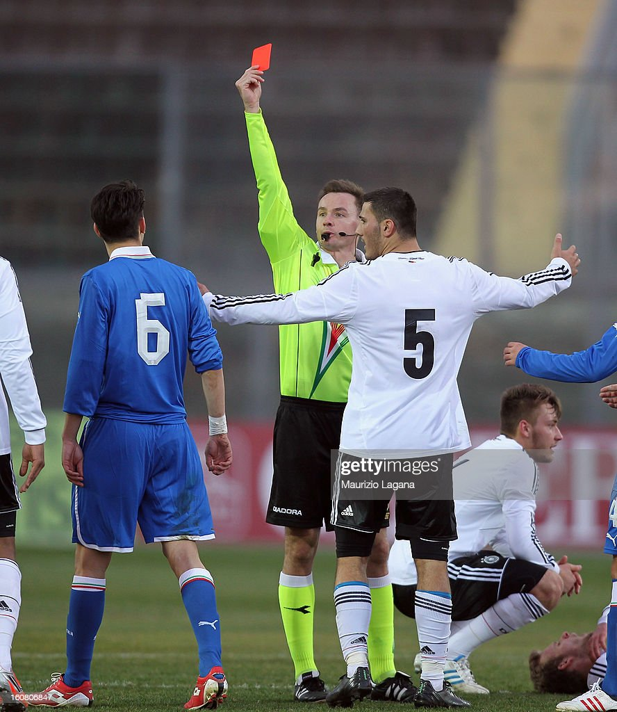 The referee Pawel Raczkowsky shows the red card to Federico Barba (L) of Italy during U20 International Friendly match between Italy and Germany at Stadio Cosimo Puttilli on February 6, 2013 in Barletta, Italy.