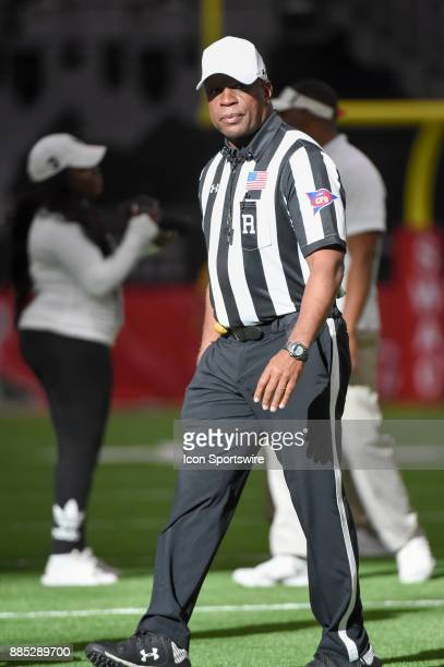 The referee prepares for the coin toss before the SWAC Championship football game between the Alcorn State Braves and the Grambling State Tigers on...