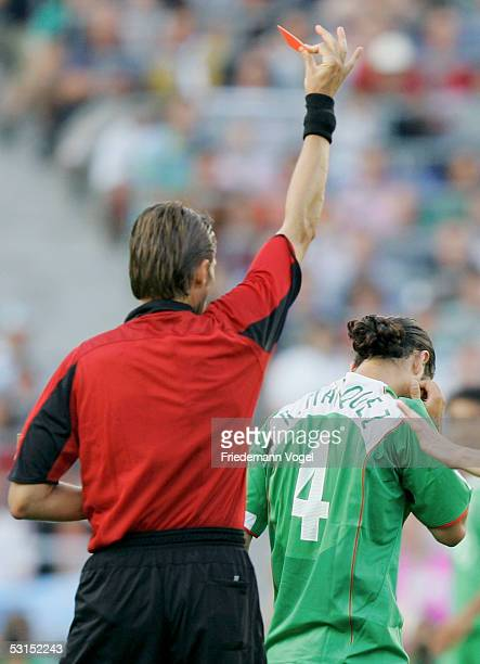 The referee Roberto Rosetti of Italy shows Rafael Marquez of Mexico the red card during the Semi Final match between Mexico and Argentina for the...