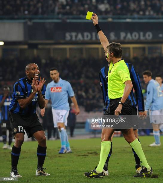 The referee Roberto Rosetti shows the yellow card to Maicon of Inter during the Serie A match between SSC Napoli and FC Internazionale Milano at...