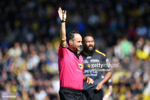 The referee Romain Poite gestures during the French Top 14 rugby union match between La Rochelle and Clermont on September 9 2017 at the Marcel...